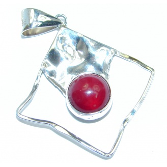 Red Fossilized Coral hammered Sterling Silver pendant