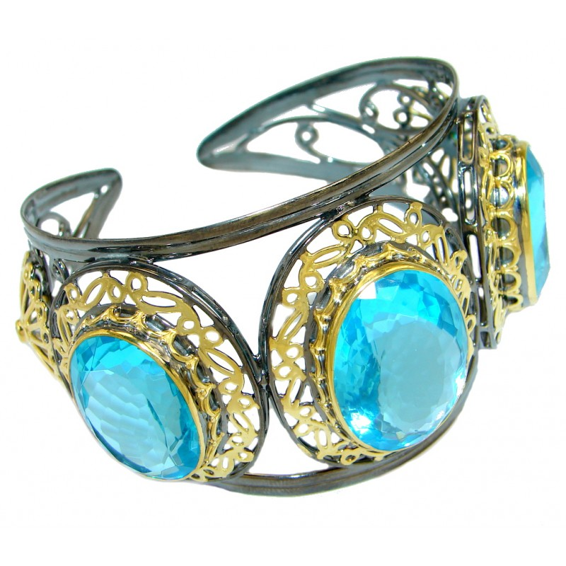Luxury Swiss Blue Topaz Gold Rhodium plated over Sterling Silver Bracelet / Cuff