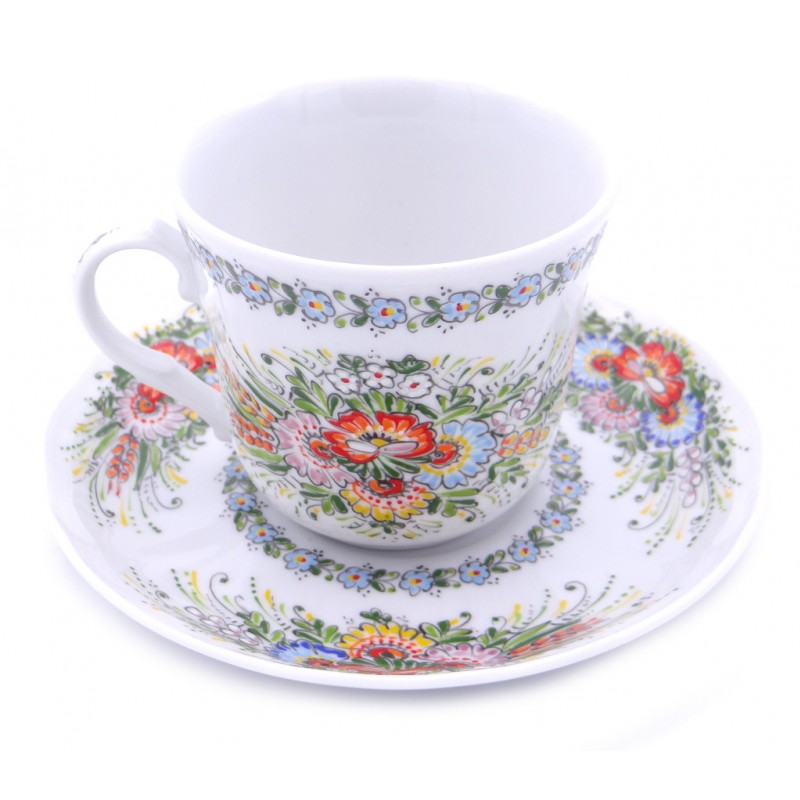 Entirely Hand painted Porcelain Cup and Saucer decorated on the inside