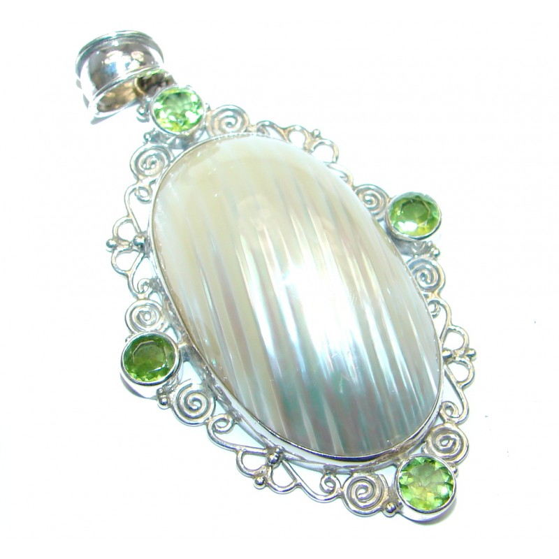 Sublime Peridot Shell Sterling Silver handcrafted Pendant