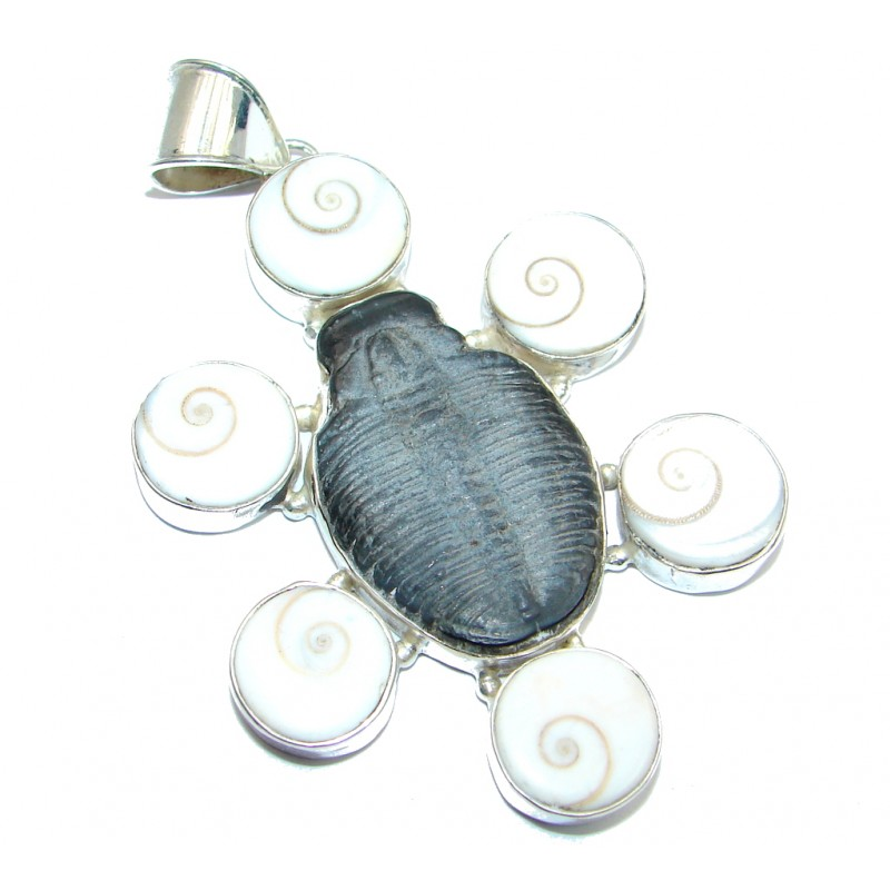 God's Gift Fossilized Stone Silver Tone pendant
