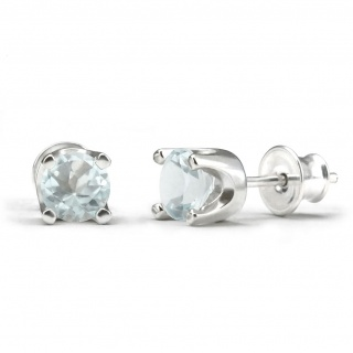 Elegant studs in sterling silver with a blue topaz