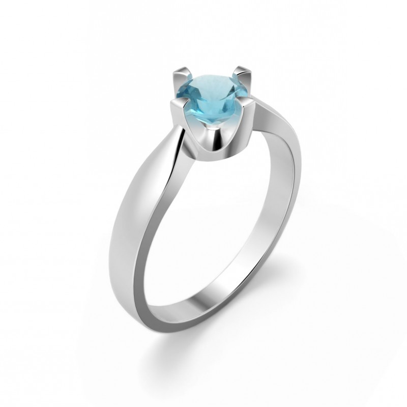 Elegant ring in sterling silver with a blue topaz
