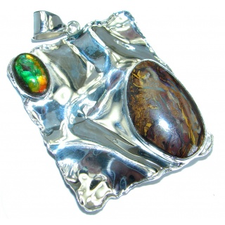One of the kind genuine Koroit Opal Ammolite .925 hammered Sterling Silver Pendant
