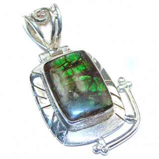 One of the kind genuine Ammolite .925 Sterling Silver handcrafted Pendant