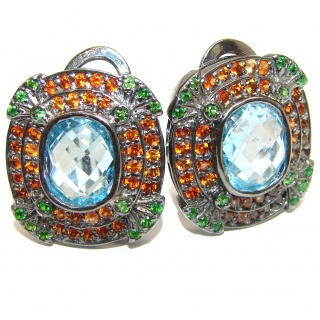 Melissa Authentic Swiss Blue Topaz rhodium over .925 Sterling Silver handmade earrings