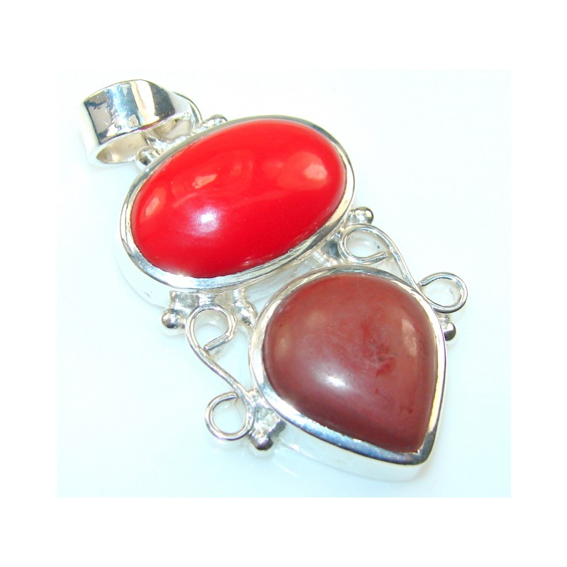 God's Gift! Red Fossilized Coral Silver Tone pendant